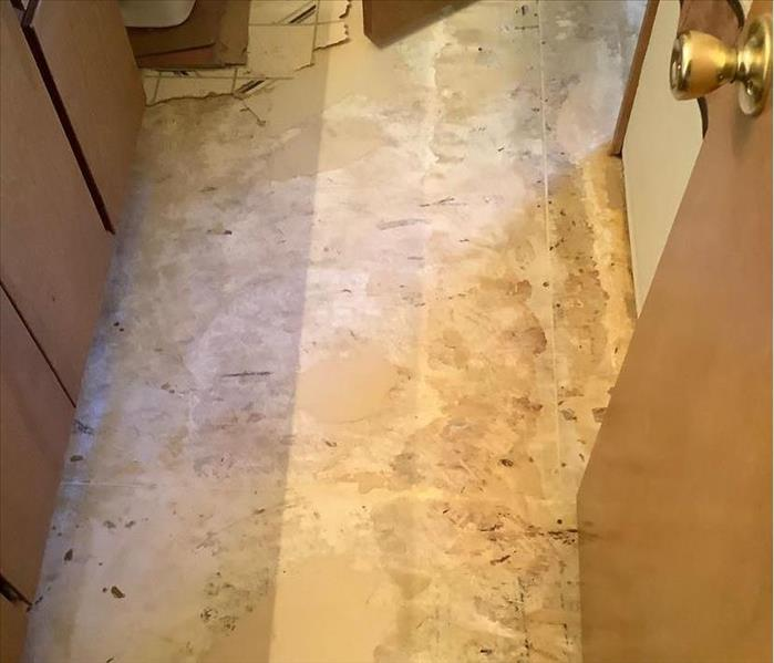A bathroom in Flagstaff, AZ, after the flooring was removed so that the room could be dried out following a leak.