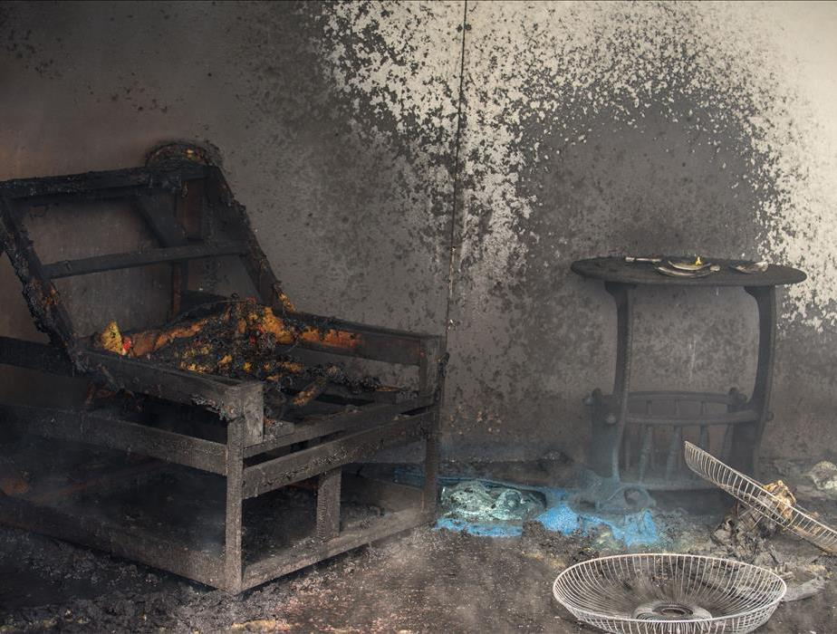 burnt chair and reading table completely destroyed in room full of soot