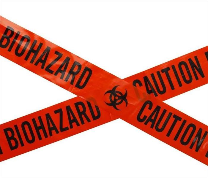 red biohazard caution tape in front of white wall