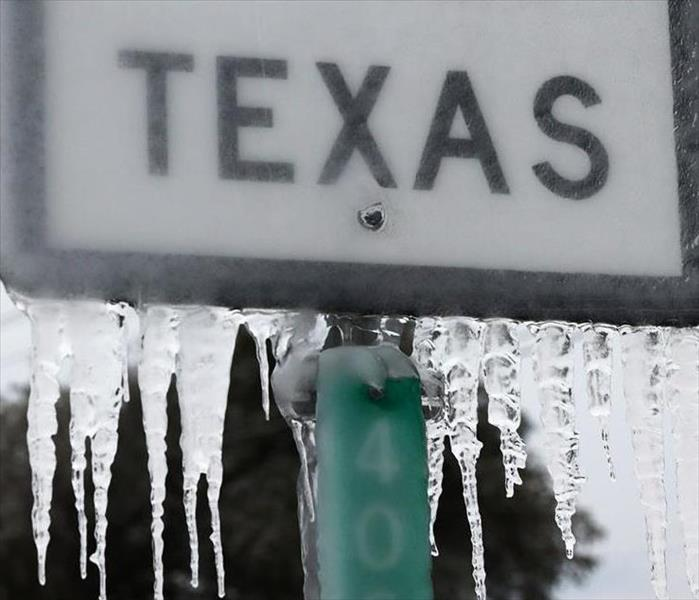 A frozen road sign that says Texas. SERVPRO is here to help with any water remediation and removal.